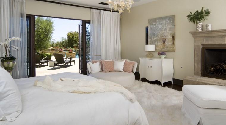 This master suite was designed by Martin Horner bed frame, bed sheet, bedroom, estate, floor, home, interior design, living room, property, real estate, room, suite, window, gray