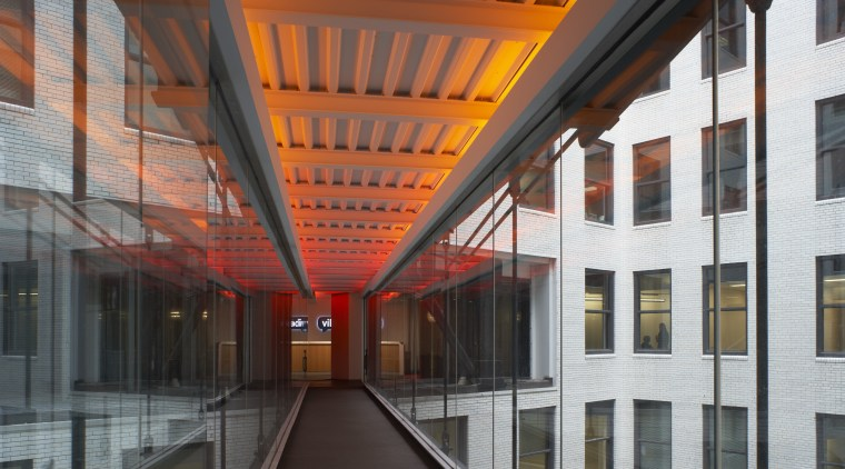 A bridge connects two sides of the offices architecture, building, daylighting, facade, black