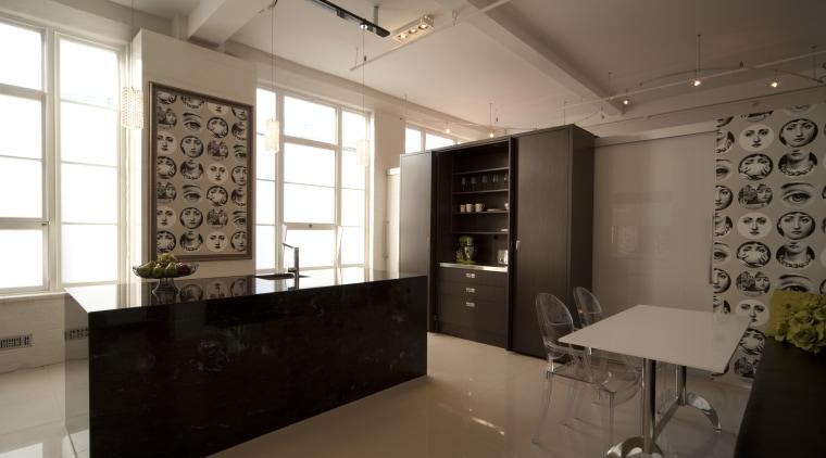 Designer Sandra Banks. Titanium Granite bench top. Allure interior design, kitchen, brown, black