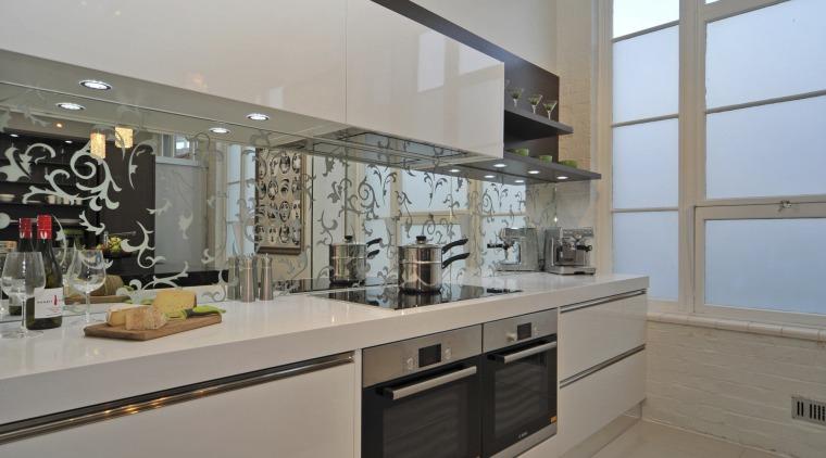 Upmarket kitchen. Designer Sandra Banks. CaesarStone Snow Qaurtz countertop, cuisine classique, interior design, kitchen, property, gray
