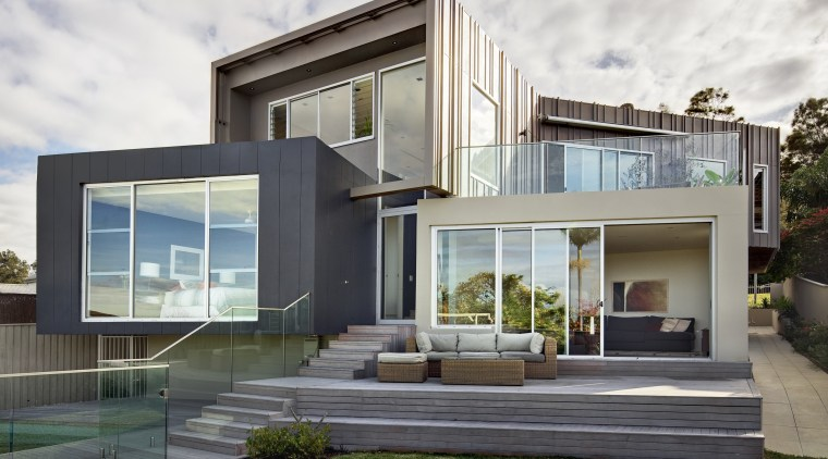 This house was designed by Andy MacDonald with architecture, elevation, estate, facade, home, house, property, real estate, residential area, villa, window, white, gray