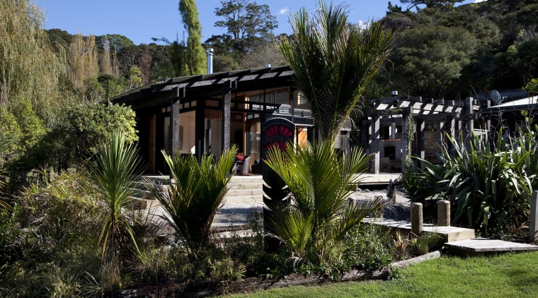 The timber for this house is treated with cottage, estate, grass, home, house, landscape, plant, real estate, tree, villa, black, brown