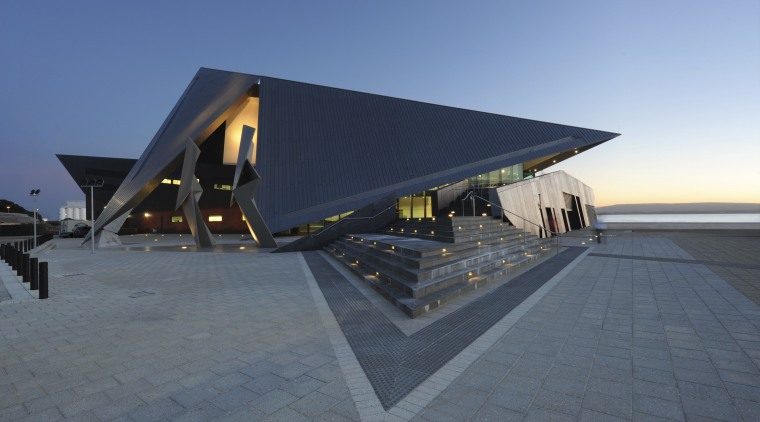 View of the exterior of the Albany Entertainment architecture, house, roof, sky, gray, blue