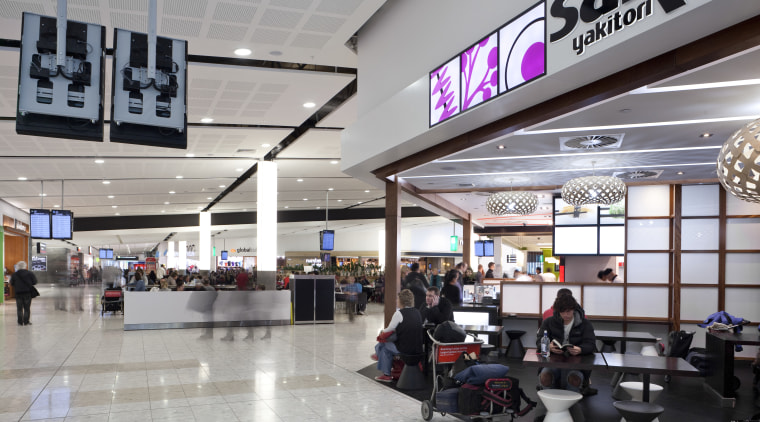 View of the interior of Christchurch Airport. airport terminal, outlet store, retail, shopping mall, gray