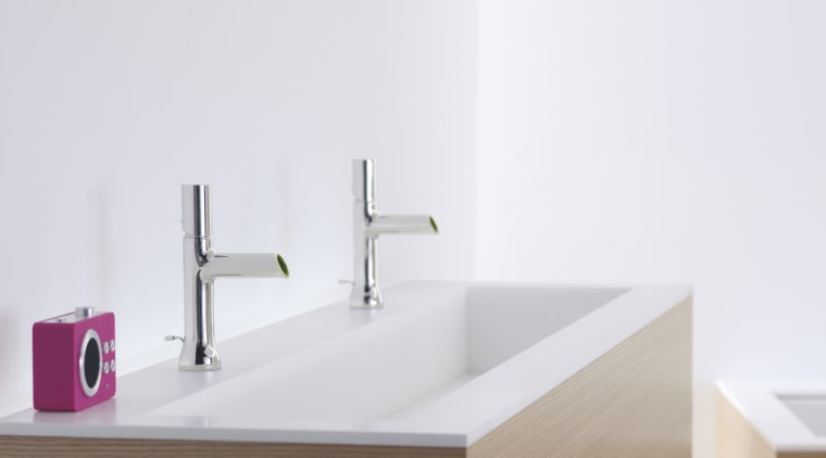 This bathroom fitting was designed by the Kohler bathroom, bathroom accessory, bathroom cabinet, bathroom sink, plumbing fixture, product, product design, sink, tap, white