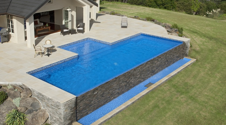 This is a view of the pool designed backyard, house, leisure, property, real estate, swimming pool, yard, brown, gray