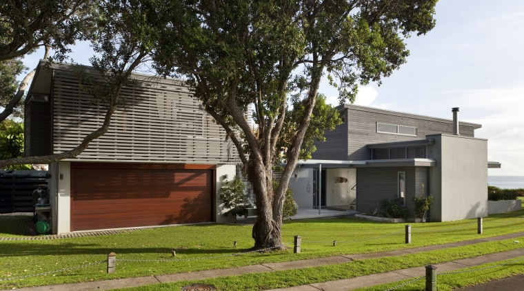 This house was designed by Hamish Cameron NZIA architecture, building, cottage, facade, home, house, neighbourhood, property, real estate, residential area, tree, brown