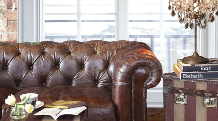 These soft furnishings were supplied and designed by brown, chair, coffee table, couch, furniture, hardwood, home, interior design, living room, loveseat, recliner, room, table, wood, white, red