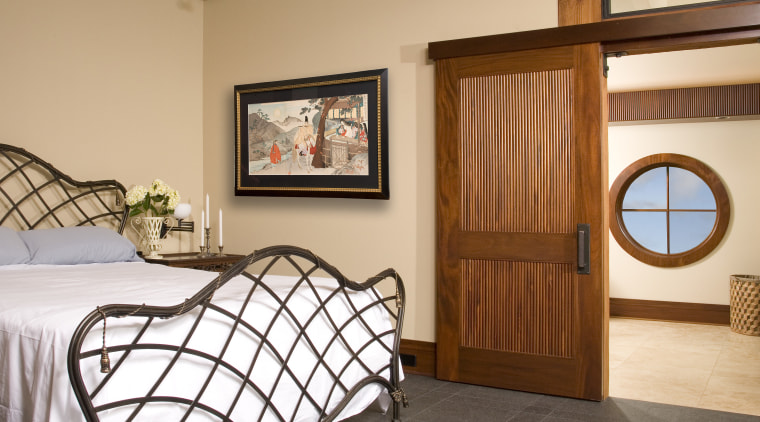 This is the master suite of the house bed frame, bedroom, door, estate, floor, furniture, home, interior design, property, real estate, room, window, wood, orange, brown