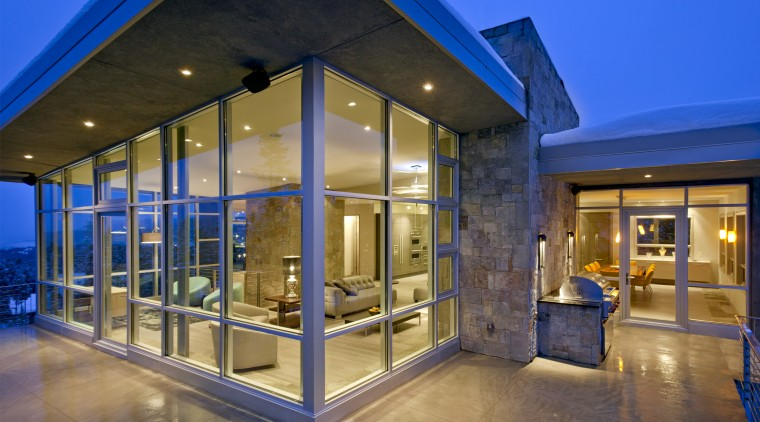The interior of this home was designed by architecture, estate, home, house, interior design, lighting, real estate, window, blue, brown