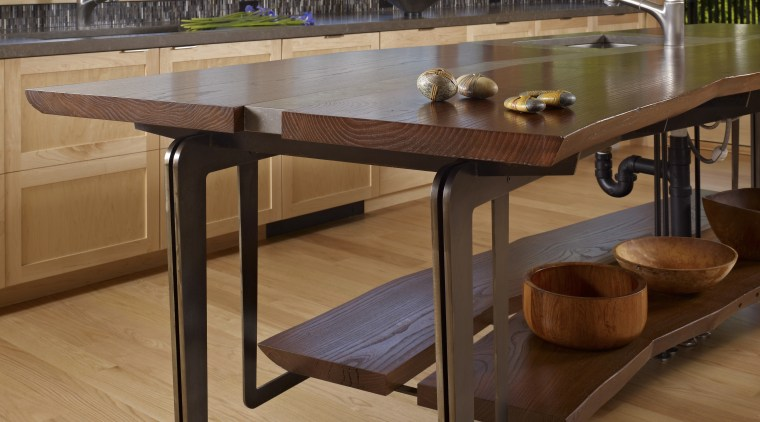 This home and kitchen was designed by Finne coffee table, floor, flooring, furniture, hardwood, table, wood, wood flooring, wood stain, brown