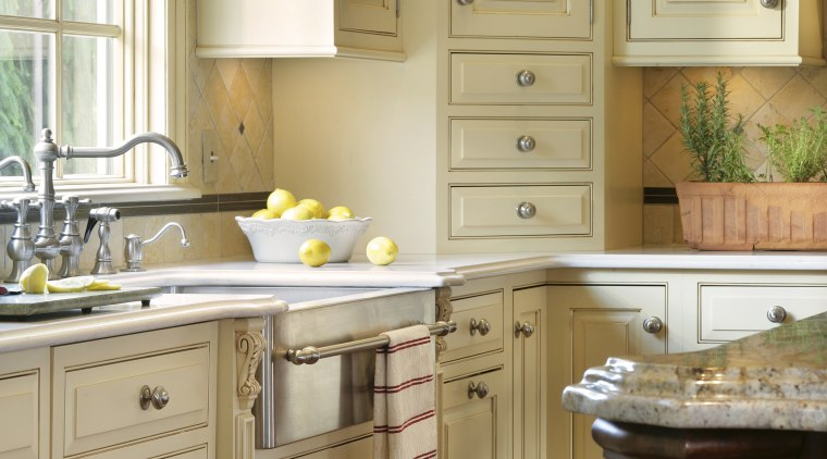 View of kitchen designed by Antoinette Fraser of bathroom accessory, bathroom cabinet, cabinetry, countertop, cuisine classique, floor, flooring, furniture, hardwood, home, interior design, kitchen, room, sink, window, wood stain, orange, brown
