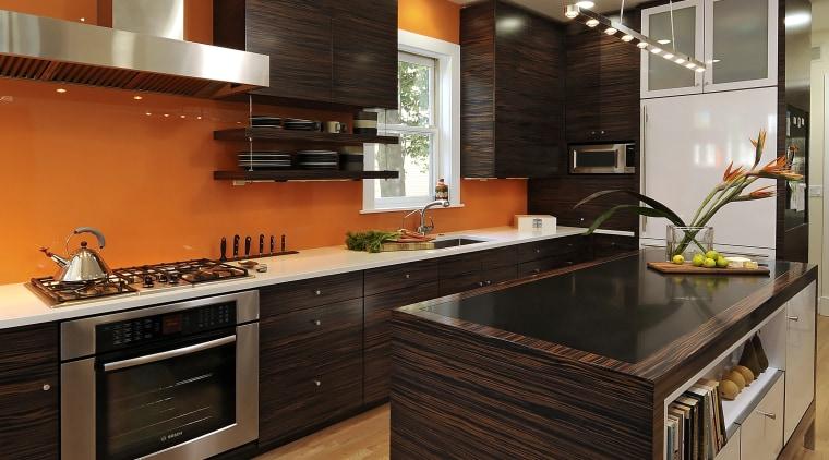 View of kitchen designed by Jennifer Gilmer.  cabinetry, countertop, cuisine classique, floor, flooring, hardwood, interior design, kitchen, laminate flooring, real estate, room, wood, wood flooring, brown, orange