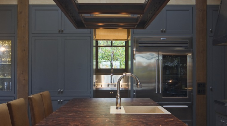 View of kitchen, great room and wine cellar. architecture, cabinetry, ceiling, countertop, cuisine classique, daylighting, home, interior design, kitchen, lighting, under cabinet lighting, wood, brown, black