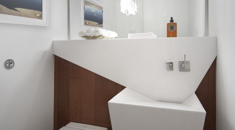 View of contemporary bathroom with wooden flooring and bathroom, bathroom accessory, bathroom sink, bidet, interior design, plumbing fixture, product design, room, sink, tap, toilet, toilet seat, gray