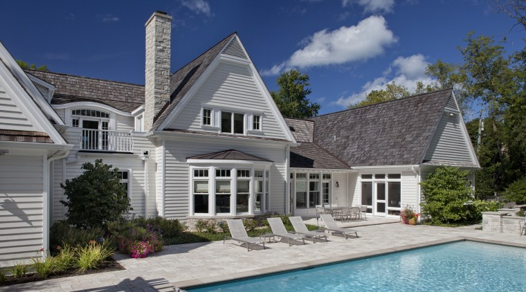 Exterior view of home with pool area. backyard, cottage, elevation, estate, facade, farmhouse, home, house, mansion, outdoor structure, property, real estate, residential area, roof, siding, swimming pool, villa, window, gray, blue