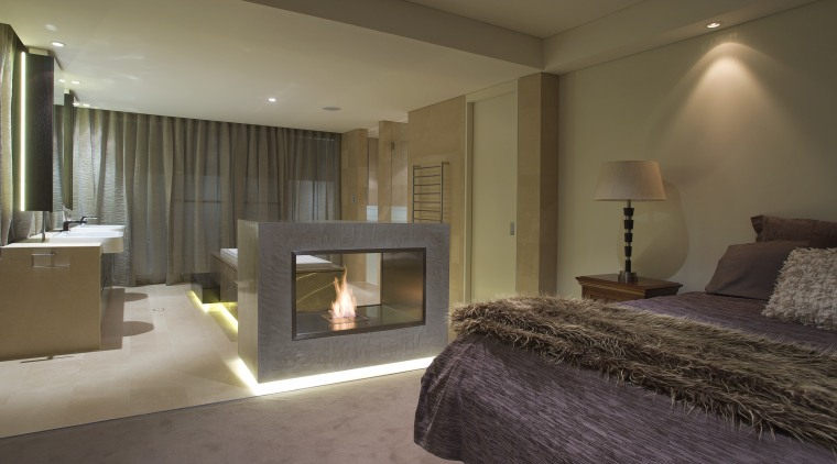 Bedroom with purple bedspread and fireplace. - Bedroom bed frame, bedroom, ceiling, floor, hearth, interior design, property, real estate, room, suite, wall, brown
