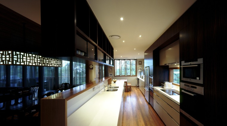 View of kitchen with wooden flooring, dark toned apartment, architecture, ceiling, daylighting, house, interior design, lighting, real estate, black, brown