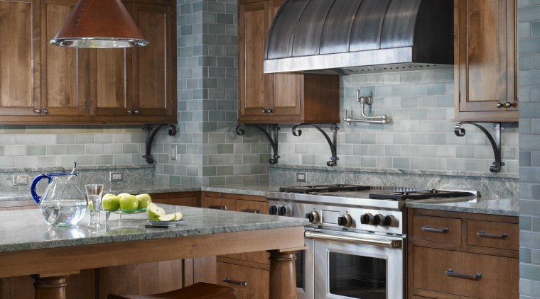 View of traditional kitchen with wooden cabinetry and cabinetry, countertop, cuisine classique, floor, flooring, interior design, kitchen, room, gray, brown