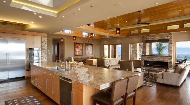 View of kitchen with wooden flooring, stone wall ceiling, countertop, dining room, hardwood, interior design, kitchen, living room, real estate, room, brown, orange