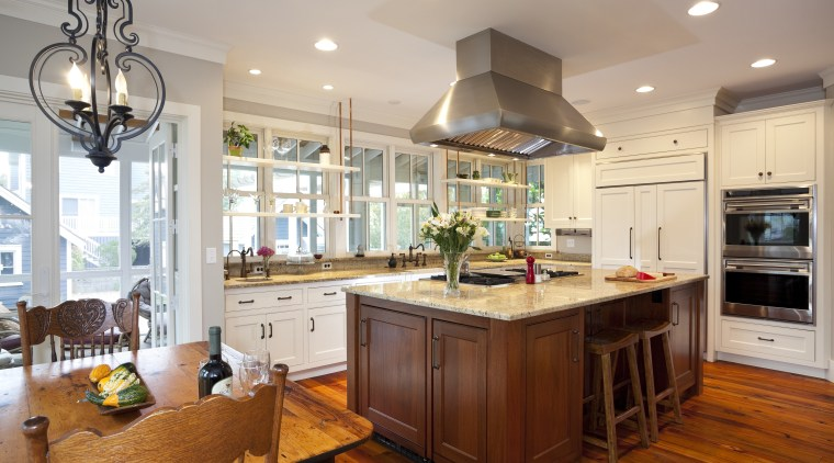 View of kitchen with wooden flooring and island, cabinetry, countertop, cuisine classique, home, interior design, kitchen, real estate, room, gray
