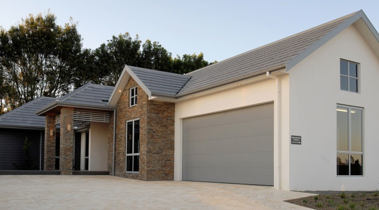 Monier Bricks & Roofing supplied and installed the building, elevation, estate, facade, garage, garage door, home, house, property, real estate, residential area, roof, siding, window, gray