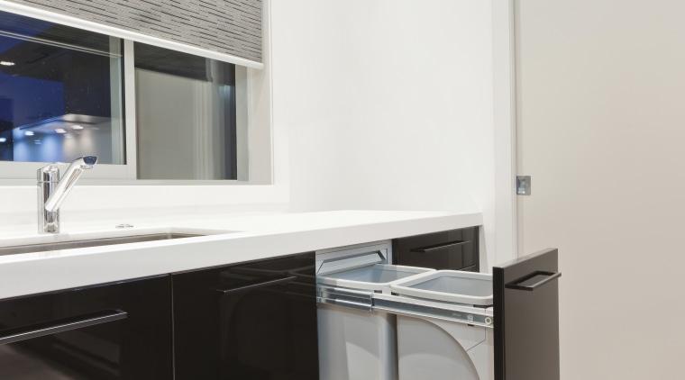View of hideaway bin in kitchen with light architecture, floor, interior design, kitchen, room, sink, white