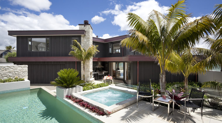 View of pool and patio area of contemporary cottage, elevation, estate, facade, home, house, palm tree, property, real estate, resort, swimming pool, villa