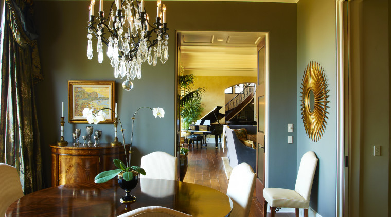 View of dining area with chandellier. dining room, home, interior design, living room, room, table, brown