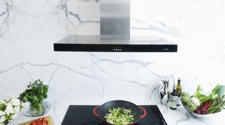 View of contemporary range and cooktop with wok. furniture, interior design, product design, table, white