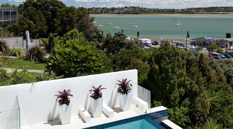 A side view of pool and look out estate, house, leisure, real estate, resort, sea, sky, swimming pool, vacation, water, teal
