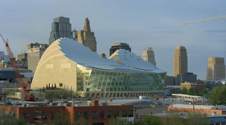 View of exterior and skyline. building, city, cityscape, daytime, downtown, metropolis, metropolitan area, roof, sky, skyline, skyscraper, structure, urban area, gray, teal
