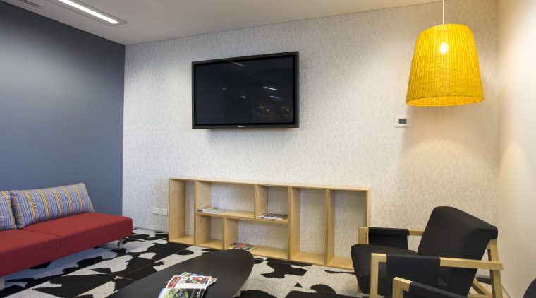 View of waiting area with tv and yellow ceiling, interior design, living room, room, wall