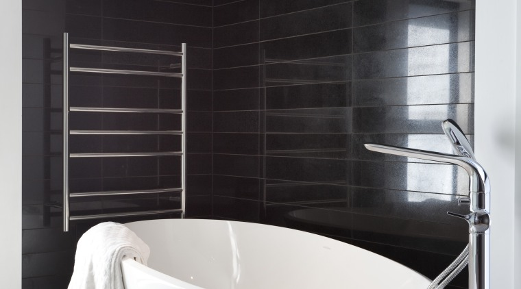 View of bathroom with black tiled walls and bathroom, floor, interior design, plumbing fixture, product design, room, sink, tap, black, white