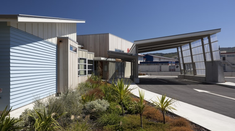 Exterior of school with landscaping. architecture, building, facade, house, real estate