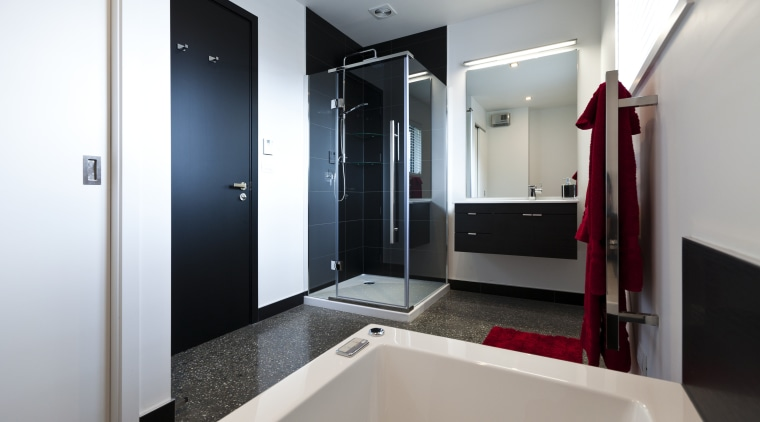 Bathroom with contemporary white tub, black door and bathroom, interior design, real estate, room, gray, white