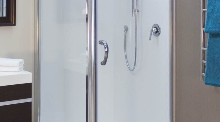 Shower enclosure with grey flooring. - Shower enclosure plumbing fixture, shower, gray