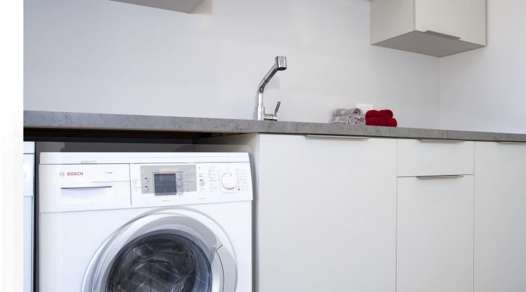 Laundry with white appliances and white cupboards. clothes dryer, home appliance, kitchen, laundry, laundry room, major appliance, product, product design, room, washing machine, gray, white