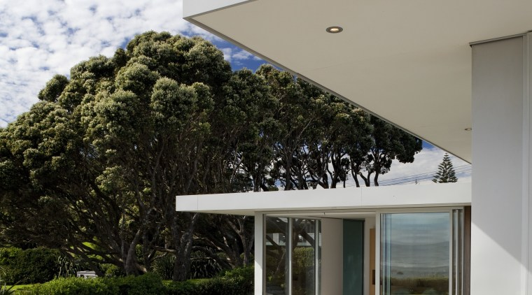 lawn and paving outside house. architecture, estate, facade, home, house, real estate, residential area, sky, gray, white