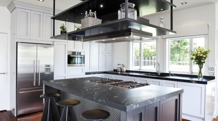 light stained wooden floors, dark island and white cabinetry, countertop, cuisine classique, floor, hardwood, interior design, kitchen, wood flooring, gray