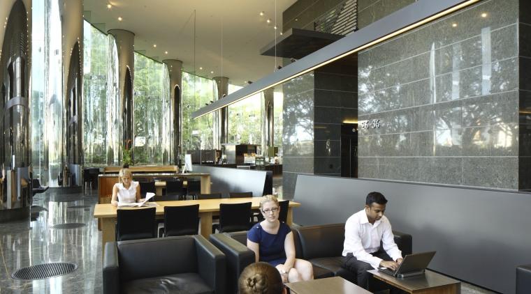 Seating area with black seats. furniture, interior design, lobby, restaurant, black, gray
