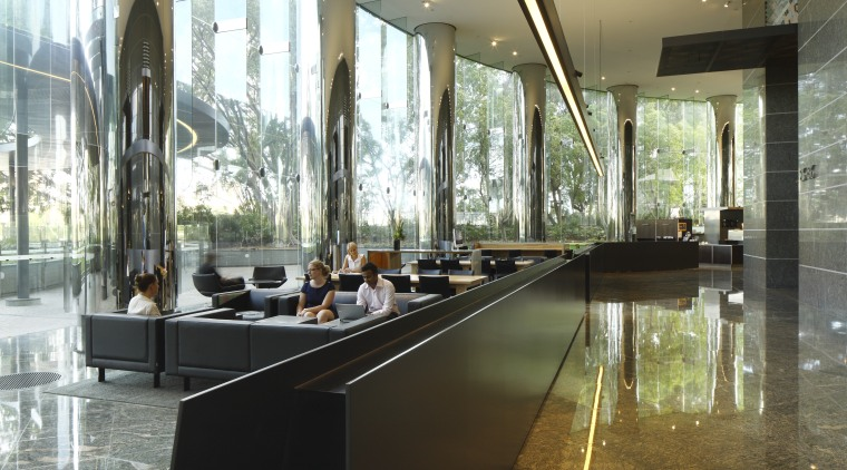 Walkway with black divider. architecture, daylighting, glass, interior design, lobby, tourist attraction, brown