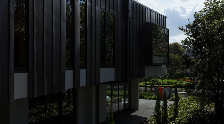 Exterior of house and garden. architecture, building, facade, grass, home, house, real estate, reflection, sky, sunlight, tree, black
