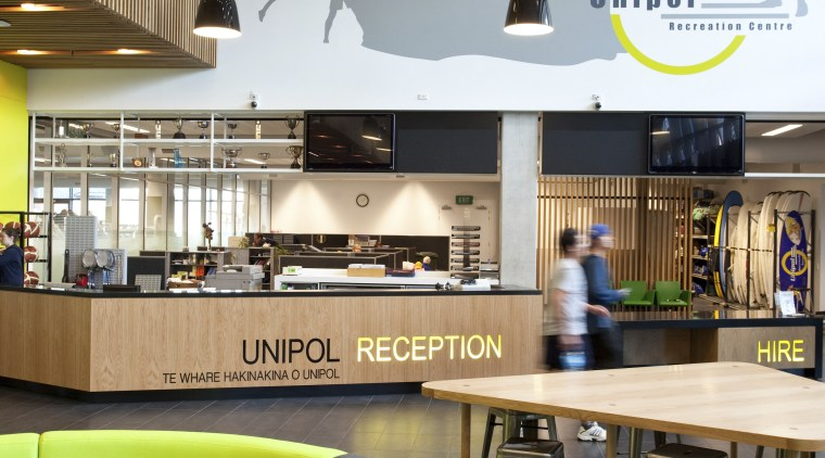 Reception area with black and lime booth seating. interior design, lobby, white