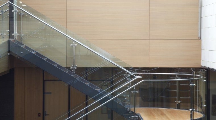 Stairs with wooden wall and grey tiled flooring. architecture, building, daylighting, glass, handrail, line, stairs, steel, structure, black, white