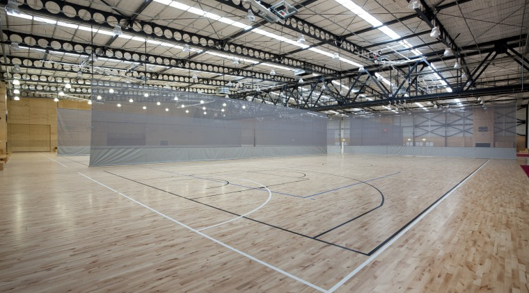 Indoor court with black and white lines. arena, basketball court, daylighting, floor, flooring, leisure centre, line, sport venue, structure, wood, gray
