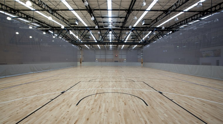 Indoor court with black lines. arena, ceiling, daylighting, floor, flooring, leisure centre, line, sport venue, structure, wood, wood flooring, gray