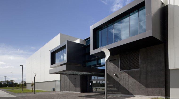 Exterior with dark grey cladding. architecture, building, commercial building, corporate headquarters, elevation, facade, headquarters, home, house, real estate, residential area, teal, gray, black
