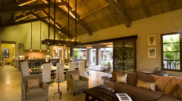 Rustic house modelled on French barn. Interiors feature interior design, living room, lobby, real estate, brown