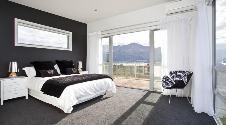 large bedroom, double sliding doors open to patio, bed frame, bedroom, estate, floor, home, interior design, property, real estate, room, suite, window, white, black